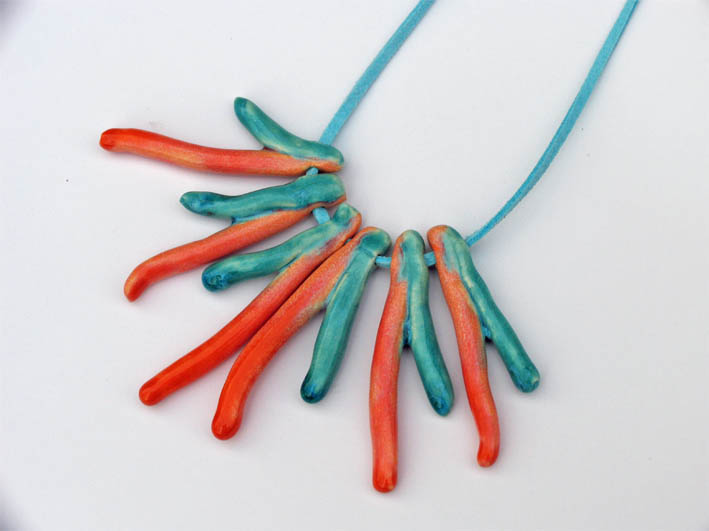 Statement necklace in shades of orange and turquoise Spring trends 2012